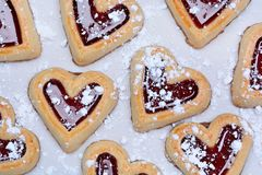 Many heart cookies on baking paper Royalty Free Stock Image