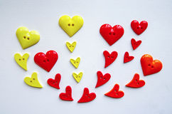 Many heart shape buttons arranged on paper Royalty Free Stock Images