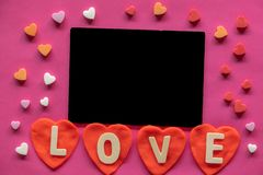 many hearts around Blackboard with word LOVE on pink background, Love icon, valentine`s day, relationships concept stock images