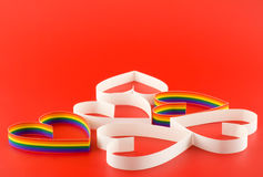 Many hearts,gay and straight on red. Royalty Free Stock Photography
