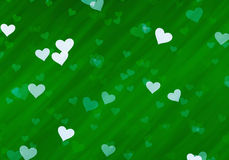 Many hearts on green backgrounds of Love symbol Stock Images