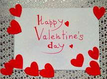 For Valentine`s Day inscription Happy Valentine`s Day and hearts royalty free stock photography