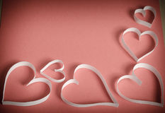 Many hearts of white paper on a red background Royalty Free Stock Photos