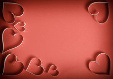 Many hearts of white paper on a red background Royalty Free Stock Images