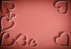 Many hearts of white paper on a red background Royalty Free Stock Photo