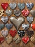 Many hearts on wood background Stock Photos