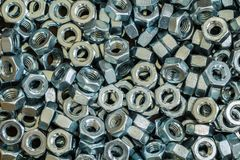 Many hex nuts. Are used in many industrial applications stock photography