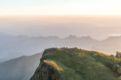 Many hikers is enjoying on the mountain ridge at sunset.  Royalty Free Stock Image