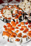 Many homemade rolls and sushi close-up Royalty Free Stock Photo