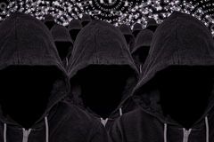 Many Hooded Faceless Computer Hackers with Binary Code stock image