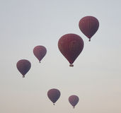 Many hot air balloons flying over the temples in Bagan, Myanmar Stock Images