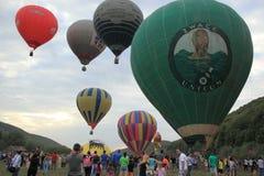 Many hot air balloons lifting off ground royalty free stock image