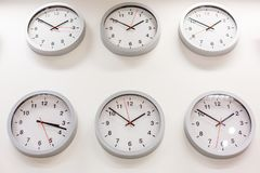 Many hours show different times royalty free stock photography