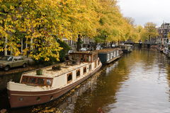Many houseboats in autumn Stock Images