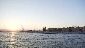 Many houses on bank of Grand Canal in Venice, sun going down, view from water stock video footage