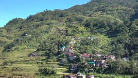 Many houses on the hill in Banaue, Philippines stock video footage