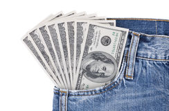Many hundred dollar bills in pocket of blue jeans. Many hundred dollar bills sticks out from pocket of blue jeans Royalty Free Stock Photo