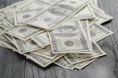 Many hundred dollar bills on wooden table Stock Photos