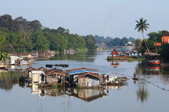Many hut and boat on river Stock Photo