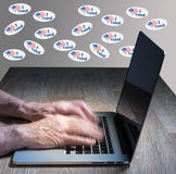 Many I Voted stickers on wall by vote hacker Royalty Free Stock Photo