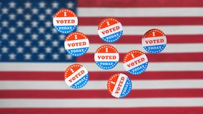 Many I Voted Today paper stickers in front of US Flag in background royalty free stock images