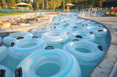 Many inner tubes floating in pool at water park Royalty Free Stock Images