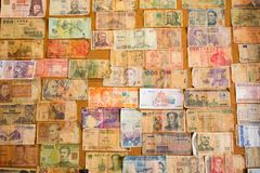 International bank notes collection on the board royalty free stock photos