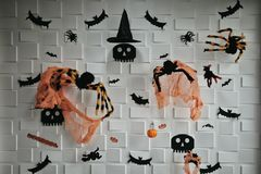Many items of Halloween decorated on white block background. Dark tone wallpaper with items such as skull, spider, bat, pumpkin, witch hat and skull royalty free stock photos