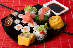 Many japanese sushiMany japanese sushi. Many japanese sushi and chopstick on black plate. Series japanese food Royalty Free Stock Image