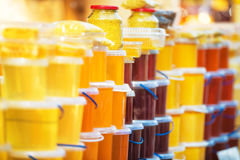 Many jars with honey Royalty Free Stock Photos