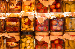 Many jars with preserved italian food with  vegetables and sardi Royalty Free Stock Photo