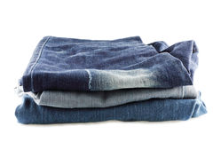 Many jeans stacked isolated  on white background Royalty Free Stock Image
