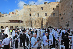Many Jews gathered for prayer. JERUSALEM, ISRAEL - SEPTEMBER 20, 2013:The Western Wall of the Temple in Jerusalem. Morning Sukkot. Many religious Jews in Royalty Free Stock Image