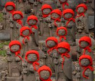 Many jizo with red hat Royalty Free Stock Images