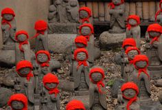 Many jizo with red hat Stock Photos