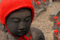 Many jizo with red hat Royalty Free Stock Photos