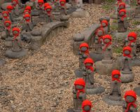 Many jizo with red hat Stock Photo