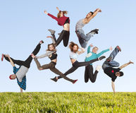 Many jumping people on the grass Stock Photos