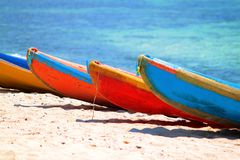 Many kayak laying on the beach Royalty Free Stock Photos