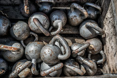 Many kettlebells weights background at fitness gym royalty free stock images