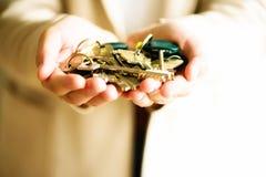 Many keys in hands on light background. Sunny morning light. Copy space.  royalty free stock photography