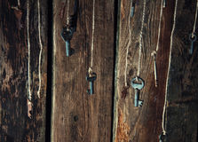 Many keys hanging on a string. Wooden background. Selective focus Royalty Free Stock Photos