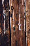Many keys hanging on a string. Wooden background. Selective focus Royalty Free Stock Photo