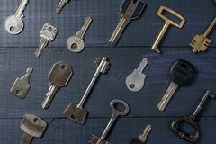 Different keys as a background stock image