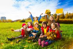 Many kids in autumn kids stock photo