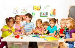 Many kids drawing and gluing Royalty Free Stock Photo