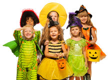 Many kids in Halloween costumes, boys and girls stock images