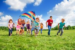 Many kids. Large group of beautiful kids boys and girls running with kids in the park Stock Images
