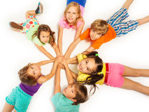Many kids laying on a floor Royalty Free Stock Image