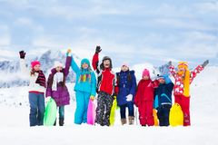 Many kids outside in winter Stock Images